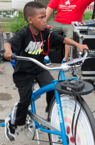 One young man uses the  Blender Bike to generate power.  © Alston Co. Photo