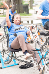 A happy participant on a recumbent bike, generating power.  © Alston Co. Photo