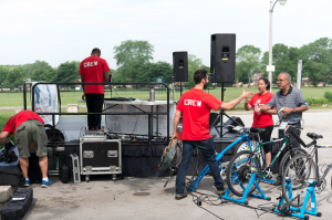 Backstage angle on the set up, with bikes to the right DJ to the left, and speakers in the distance.  ©Alston Co. Photo